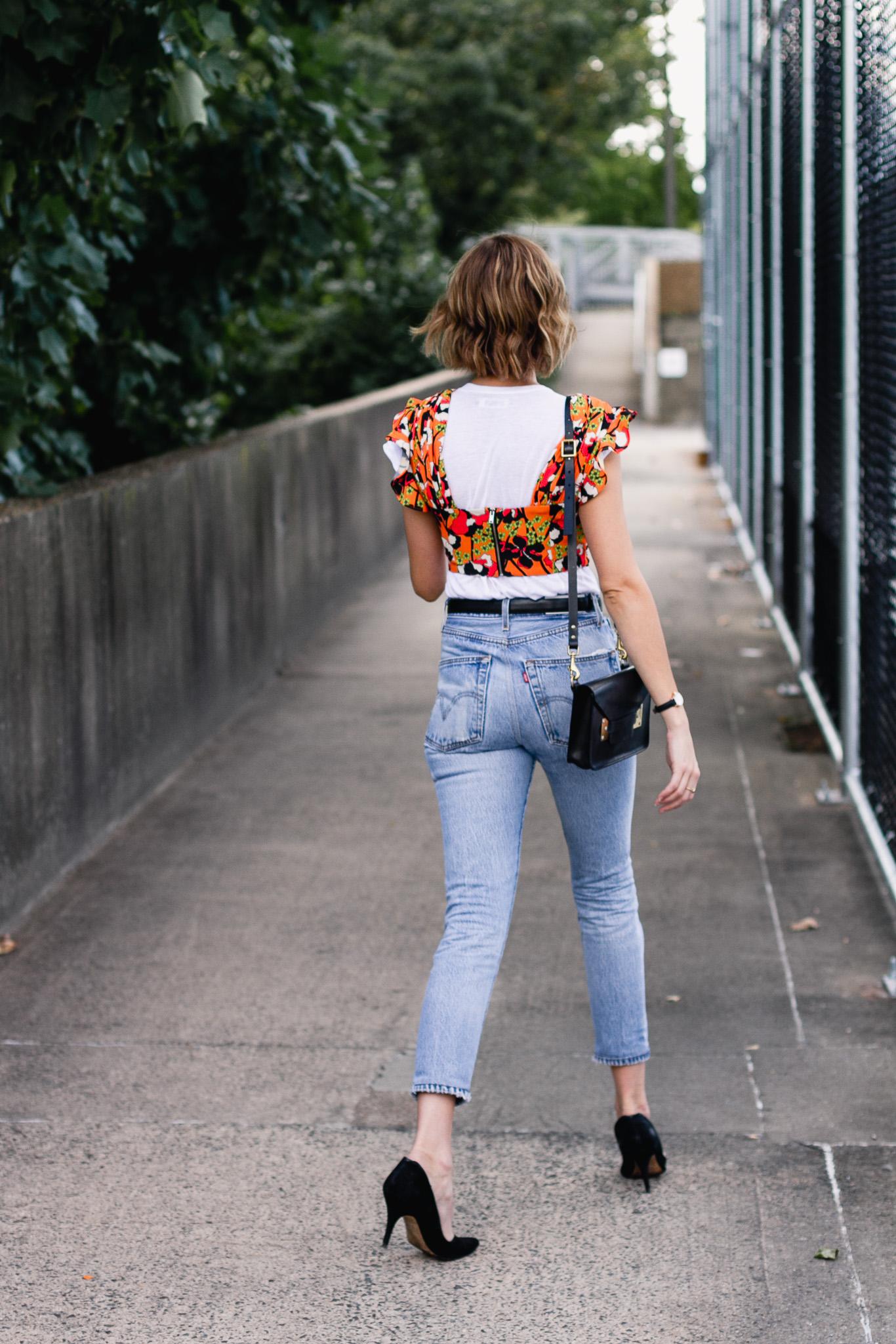 Mango crop top, Ferragamo belt, and Re/Done jeans