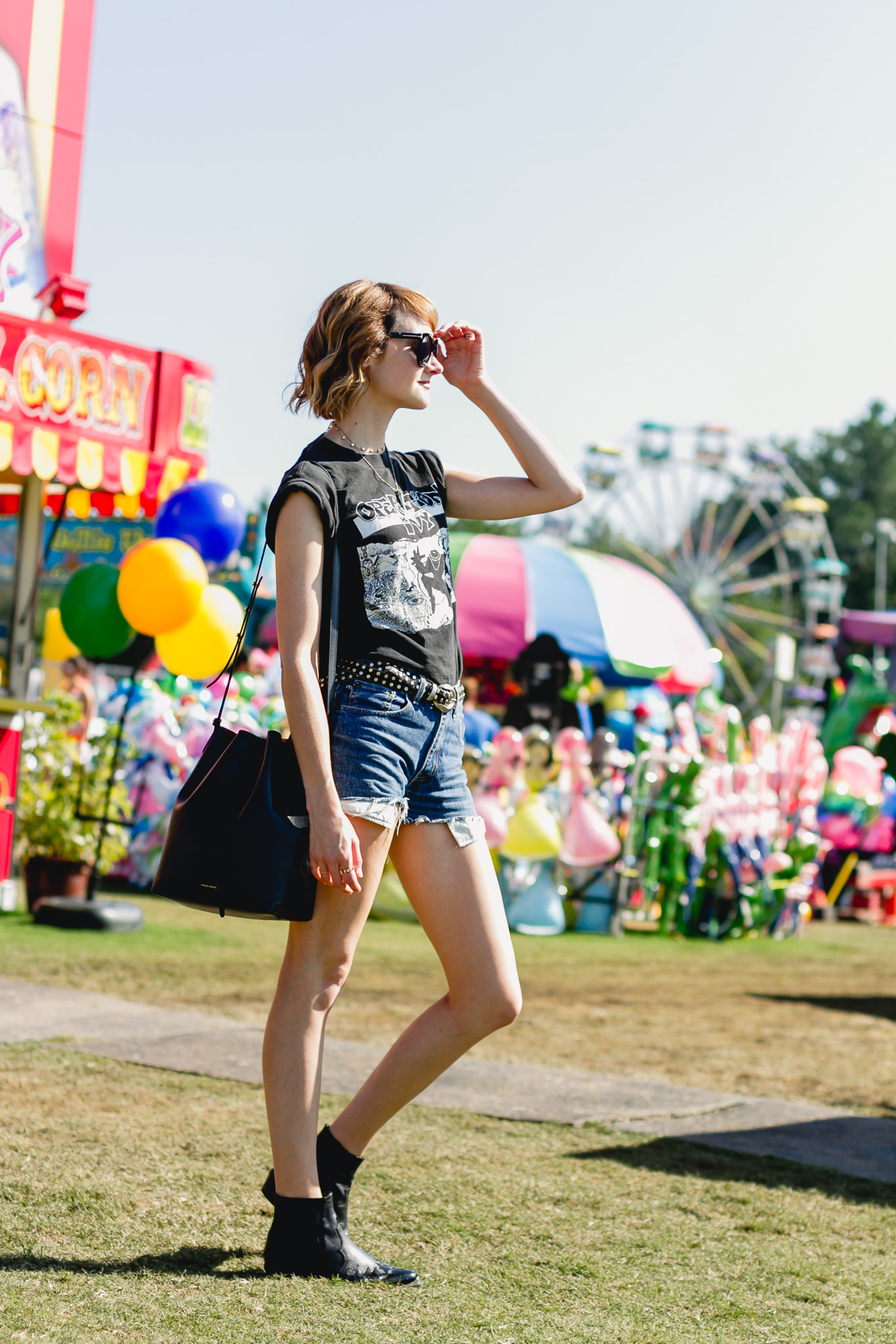 Op Ivy t-shirt, denim shorts, and Topshop western boots