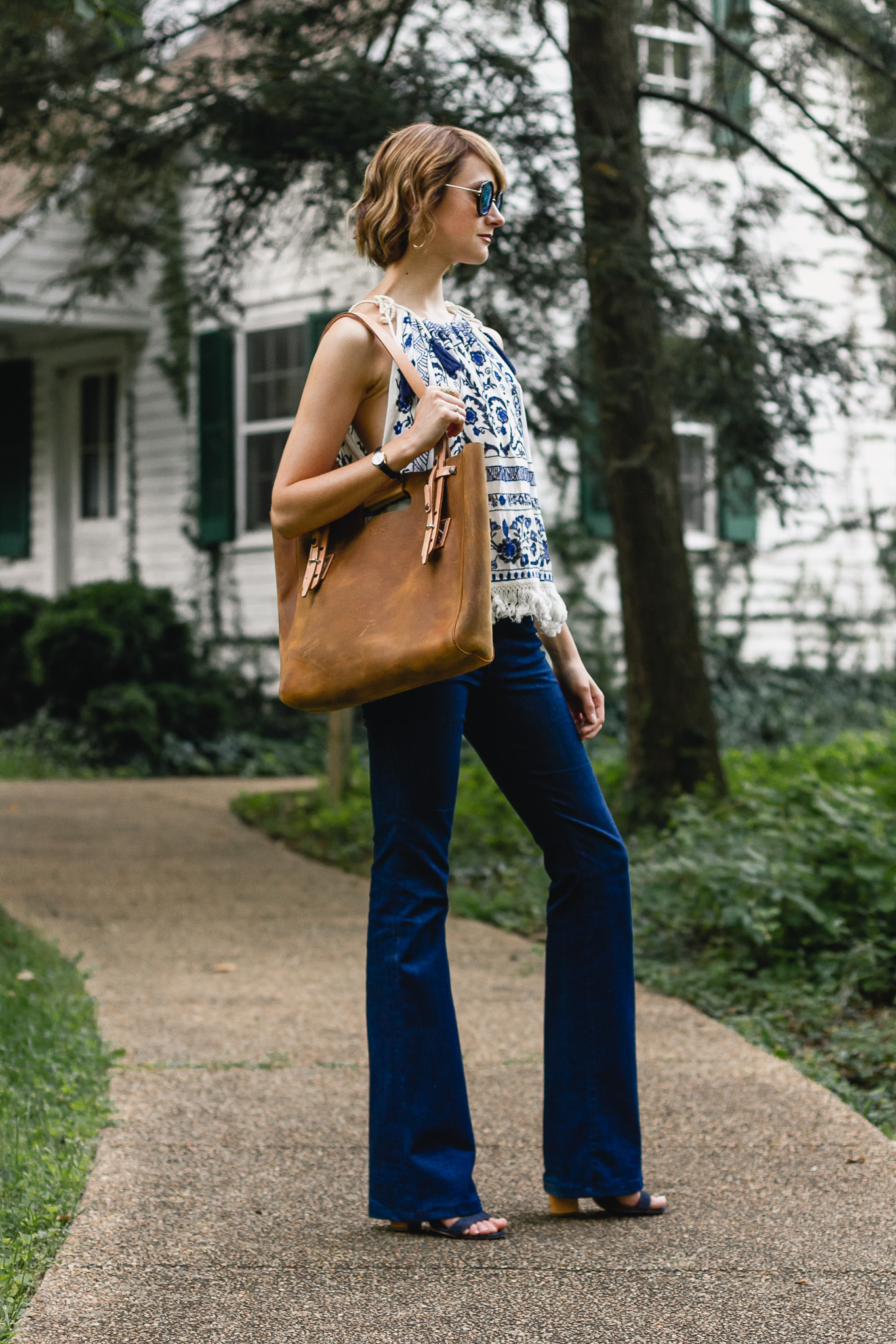Mango top, J brand flare jeans, and Saddleback Leather bag