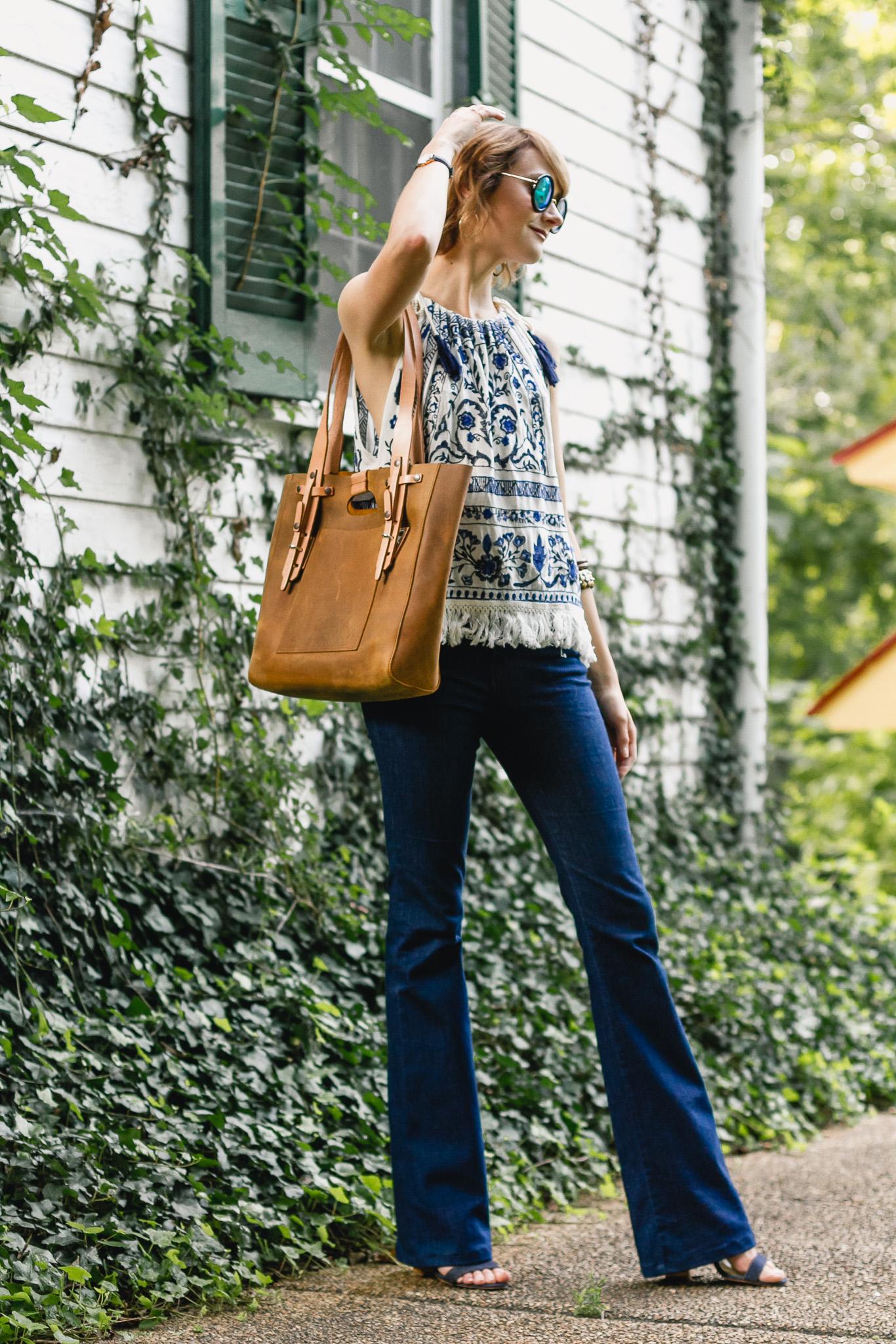Mango top, J brand flare jeans, and Saddleback Leather bag