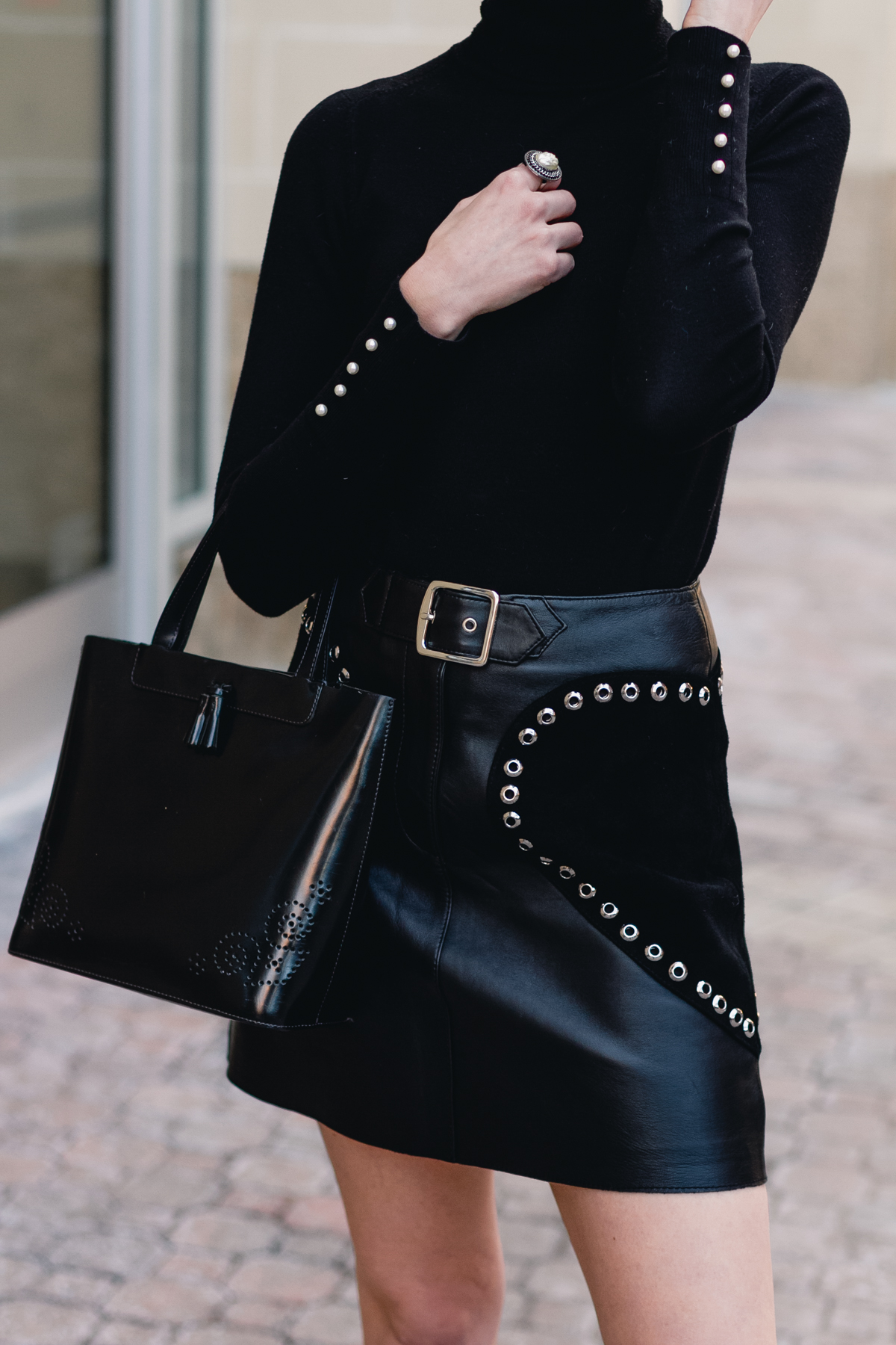 black turtleneck and Maje leather skirt