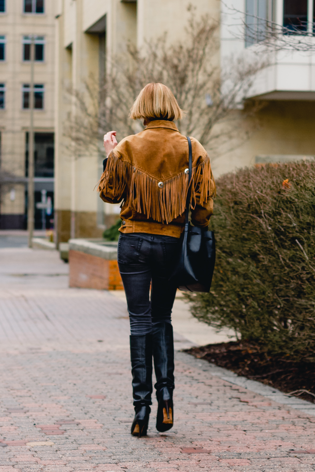 fringe leather jacket and slouchy boots