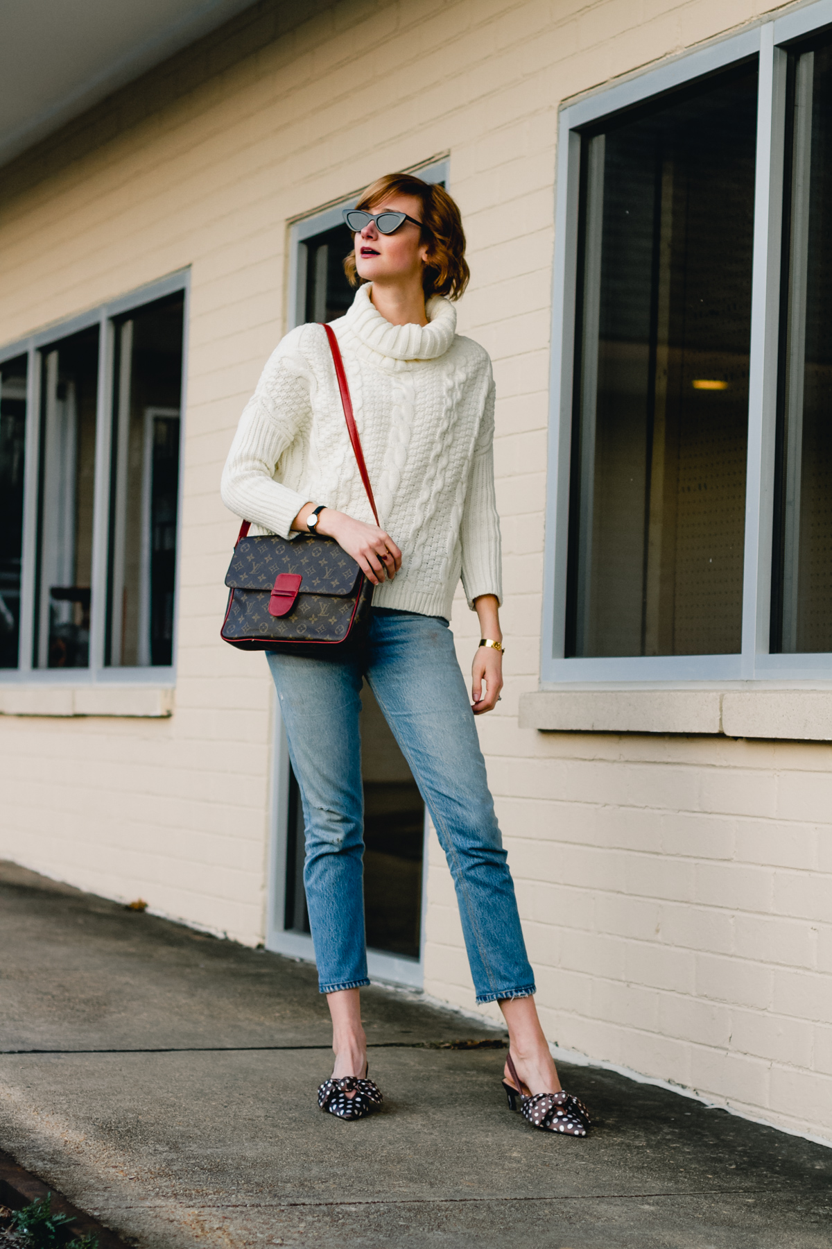 cableknit, RE/DONE jeans, and LV bag