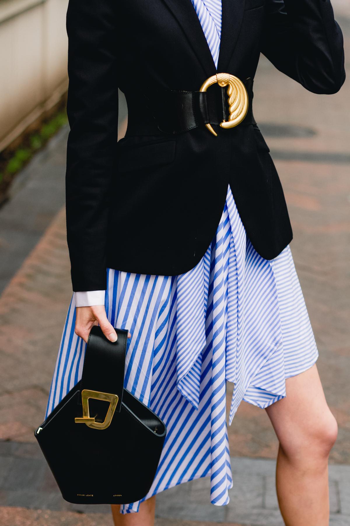 belted blazer and striped asymmetrical dress