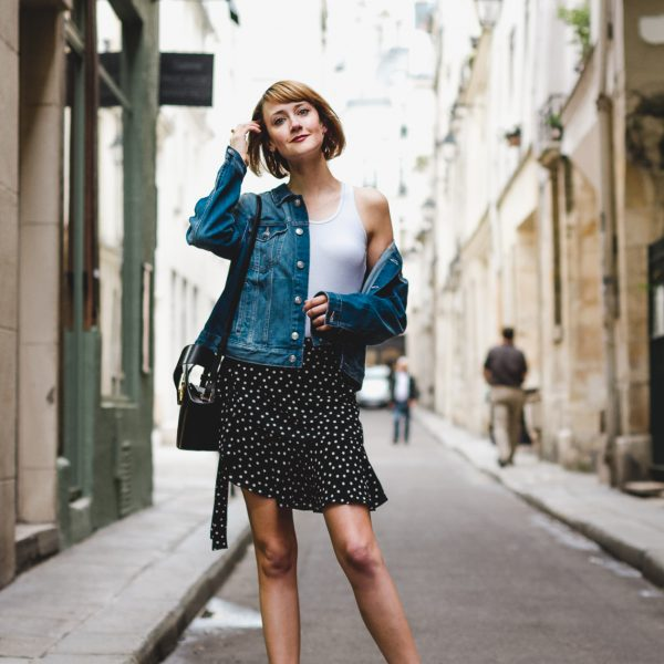 denim jacket, polka dot skirt, and white ankle boots