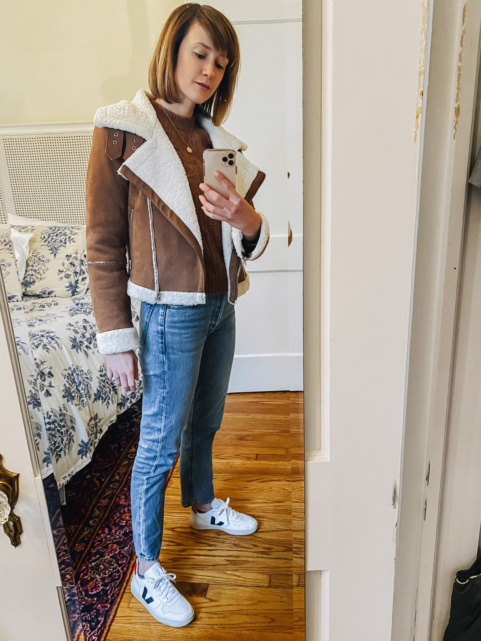 leather jacket, jeans, and Veja sneakers outfit
